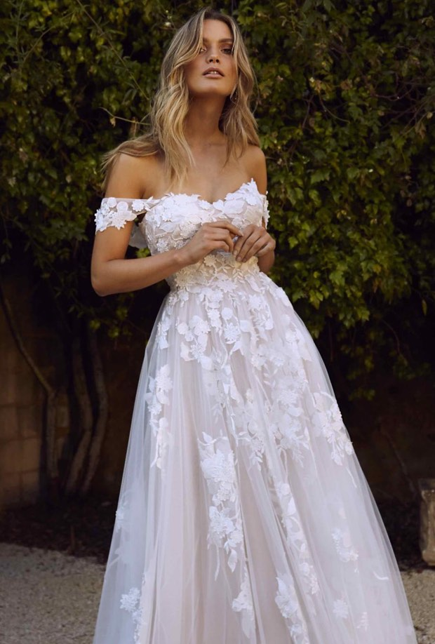 Model wearing a bridal Madi Lane gown